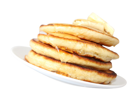 A pancake is a flat cake, often thin, and round, prepared from a starch-based batter that may also contain eggs, milk and butter and cooked on a hot surface such as a griddle or frying pan, often with oil or butter. They may be served at any time with a v