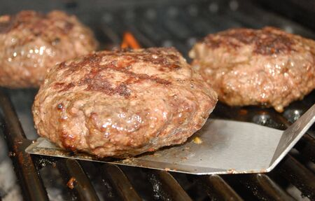 Grilling hamburger time. Stock Photo