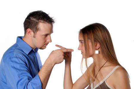 Couples in a confrontation point fingers at each other