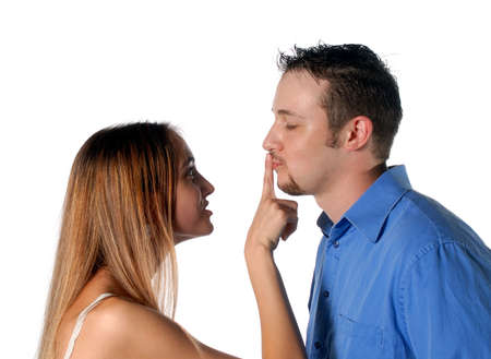Her telling him to be quiet by placing finger on his lips.