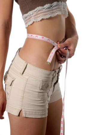 measured: Female waist being measured metric measurement Stock Photo