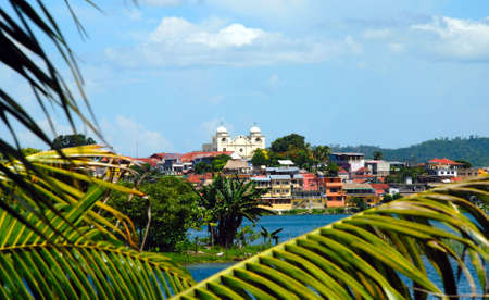 Flores Guatemala Central America through the palm trees.r