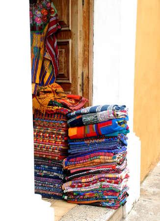 Handmade linens on the doorway along streets of Antigua