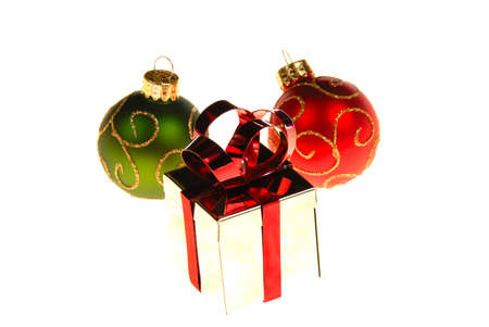 Christmas gift box with ornaments around it. isolated on white. Stock Photo - 3984242