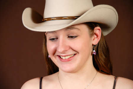 Happy cowgirl looking downward Stock Photo - 4168061