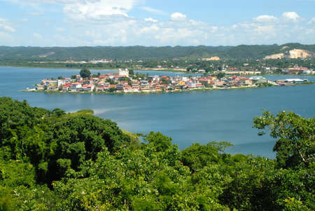Lake around tourism town of Flores Guatemala Central America. Photo from tree tower near where a dig for ruins still exists.