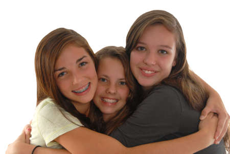 Friends three teenage girls hugging and happy. Best friends forever. In studio on white background. Isolated.