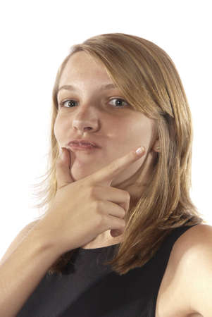 pucker: Young girl with hands on chin as if thinking and pointing with a pucker look on lips or I have an Idea. Stock Photo