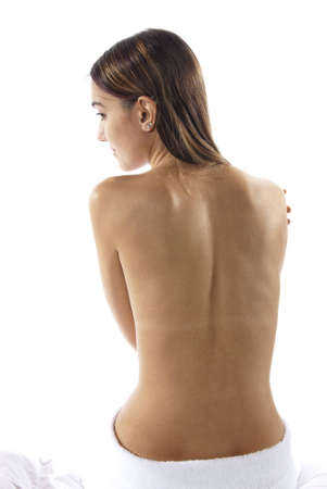 nude woman back: Pretty brunette woman enjoys the spa treatment, relaxation, and body care. Isolated on white studio shoot.  Stock Photo