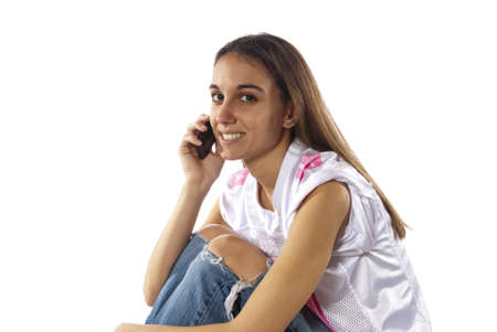 Young woman sitting using phone to make calles, texting, email, communication, chatting, with her friends. In studio on white background