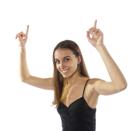 Pretty young youthful, slim, healthy woman arms up in the air saying were number one,  cheering, happy. Winner or winning. Were first.  On white background. Stock Photo - 11790722