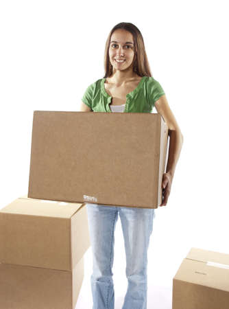 Pretty homemaker packing to move to a new home or just moved in and moving stored items around to different rooms in the house. In studio on white background.