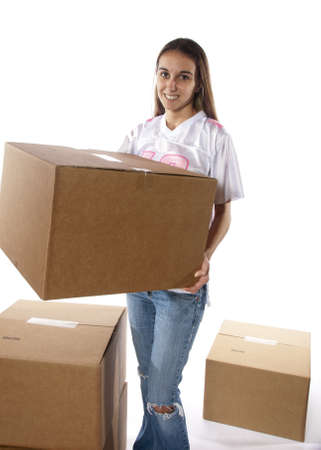 Pretty homemaker packing to move to a new home or just moved in and moving stored items around to different rooms in the house. In studio on white background. photo