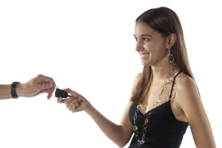 Pretty young woman getting car keys. isolated on white in studio. Stock Photo - 11964450