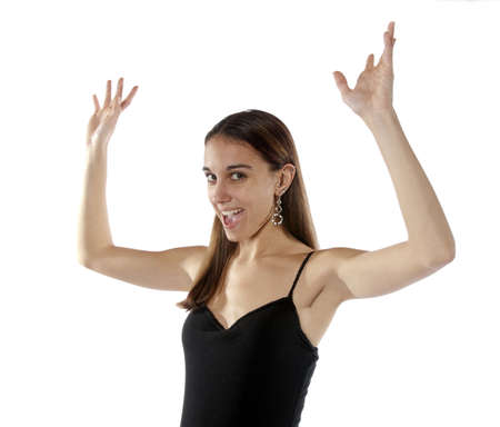 Pretty young youthful, slim, healthy woman arms up in the air say gesturing cheer, happiness, or over here. On white background. Stock Photo