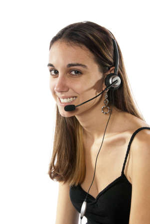 Pretty young woman telephone switchboard operator, help center, contact person, wearing headset ready to take your phone call dressed nicely smiling  photo