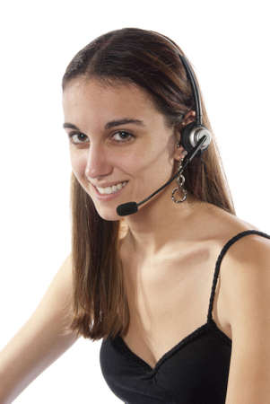 sales representative: Pretty young woman switchboard operator, looking into camera and happy wearing head set and microphone to take your calls  In studio on white background  Stock Photo
