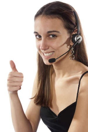 Pretty young woman switchboard operator, looking into camera and happy wearing head set and microphone to take your calls  In studio on white background  photo