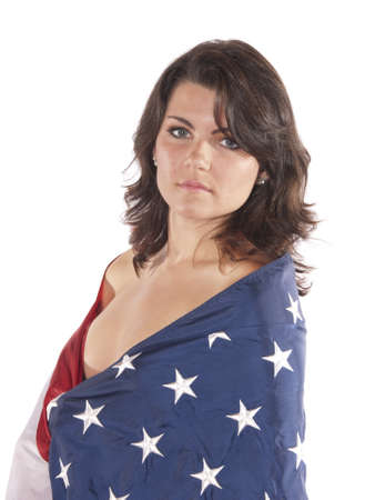 young woman implied nude wrapped American Flag looking into the camera seductively. Patriotic, for the holidays fourth of July, independence day, flag day