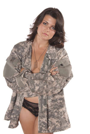 Sexy young woman holding part of an American soldiers uniform. Standing nude wearing only panties. Patriotic,