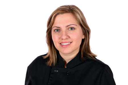 Beautiful blond wearing black chef coat in the restaurant food server industry  In studio on white background