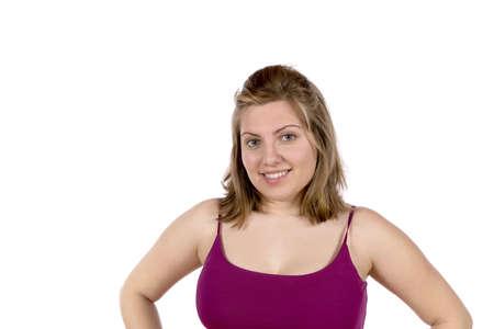 Portrait of a pretty blond woman wearing a tight purple spaghetti strap shirt  In studio on white