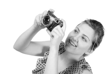Retro black and white monochrome of beautiful young blond woman holding an antique camera  Hair teased up in bun  Photo in studio on white background and in Black and white Stok Fotoğraf - 18493856