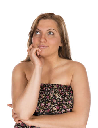 Pretty blonde woman in strapless and sleeveless dress happy thinking had on chin and making expressions towards camera  In studio on white background