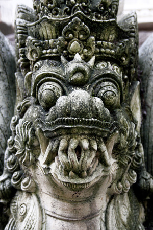 Traditional Balinese stone demon sculpture at Bali, Indonesia. Stock Photo