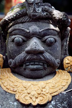 Traditional Balinese stone demon sculpture at Bali, Indonesia. 版權商用圖片