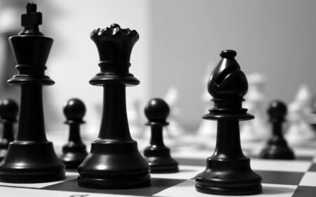 chess board: Chess game seen from one side Stock Photo