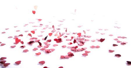 blower: small confetti heart falling on white