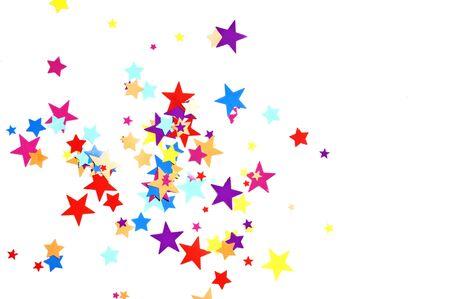 year 's: colored stars confetti on white