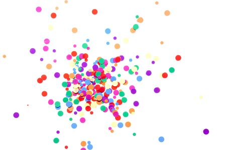 confetti background: colored round confetti spilled on white