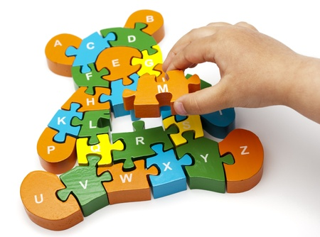dispersed: solving bear puzzle letters with childs hand copy