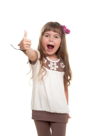 cute little girl showing ok sign against white background photo