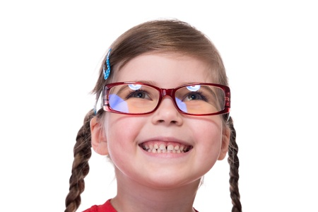 close up portret of little girl wearing glasses and looking up photo