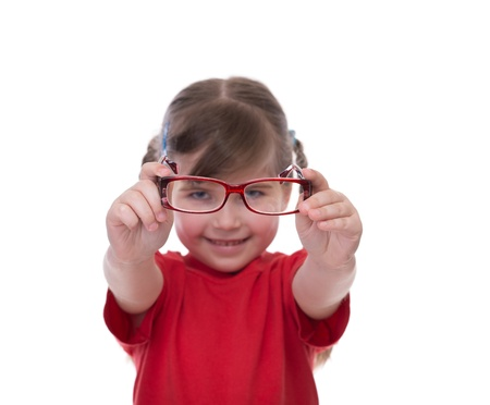 Cute little girl holding glasses and looking thru it isolated on white photo