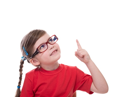 little girl wearing glasses and pointing by forefinger to somewhere up isolated on white photo