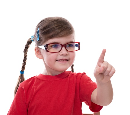 little girl wearing glasses and pointing by forefinger to somewhere isolated on white photo