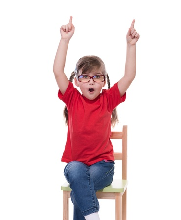red tshirt: little girl wearing red t-shirt and glass pointing to somewhere or something up isolated on white