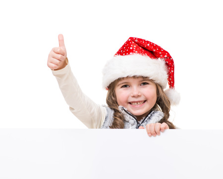 christmas girl: cheerful girl holding white board and showing ok sign Stock Photo