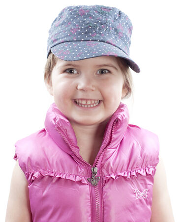 little girl wearing baseball cap and smiling on white photo