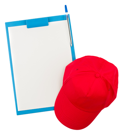 topdown: top down view of clipboard and red cap isolated on white