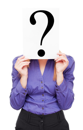 Young business woman cover her face by sheet of paper with big black question mark on white photo