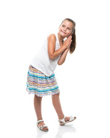 aside: little girl dancing clap hands and looking aside Stock Photo