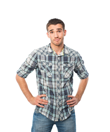 model male: hasitate young man standing in front of camera keep hands on waist
