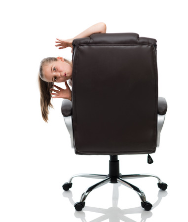 seek: lets play hide and seek. Im on the armchair Stock Photo