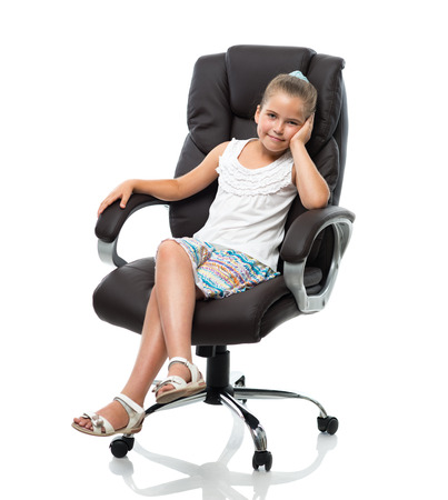 little girl sitting in big office armchair on white background photo