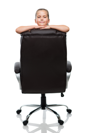 lean on back of the black office armchair and smiling photo